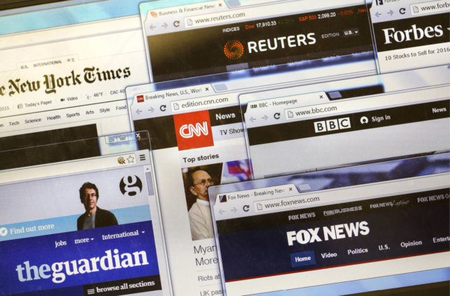 World news outlets all pulled up on computer.