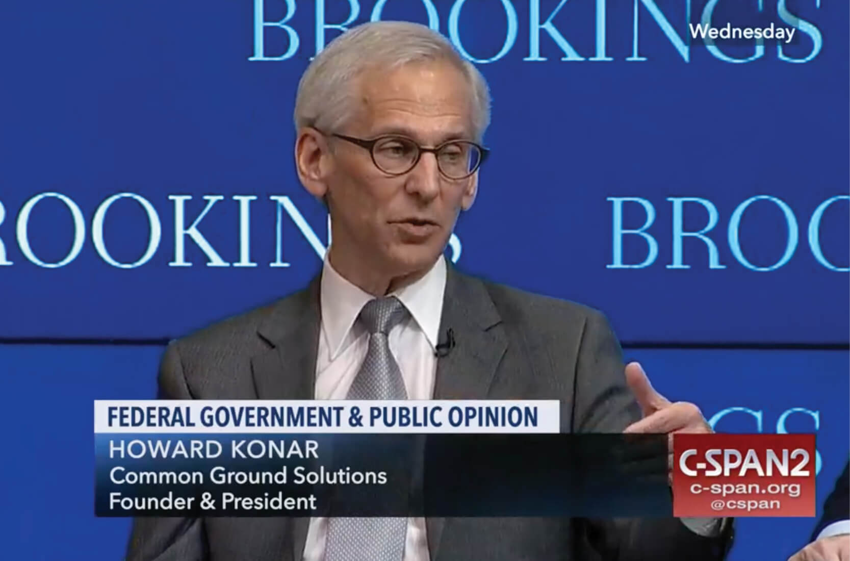 Howard Konar speaking to crowd at Brookings panel discussion