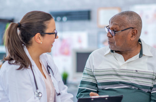 Common Ground Solutions Website Graphic Elderly Male Patient With Health Care Provider