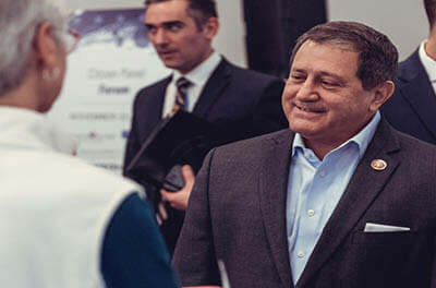 Congressman Joe Morelle shaking hands with an attendee at the Citizen Panel event