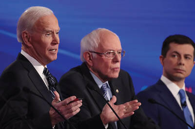 ormer Vice President Joe Biden, Sen. Bernie Sanders, and former South Bend, Indiana, Mayor Pete Buttigieg during the Democratic presidential debate in Des Moines, Iowa, on January 14, 2020.