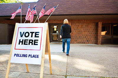 Woman walking into polling place