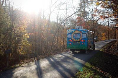 School bus driving down rural road