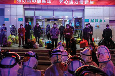 Wuhan patients infected with the coronavirus wait to be transferred to a different hospital