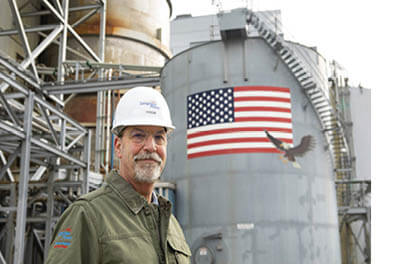 Steve Nelson of Longview Power standing outside a coal-powered energy plant
