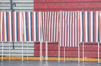 Voting booths stand empty during the New Hampshire Presidential Primary at Bedford High School in Bedford, N.H., on Feb. 11, 2020