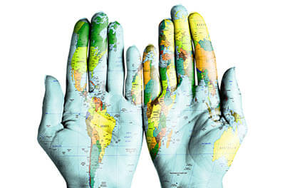 Photo of two hands palm up, superimposed by a world map