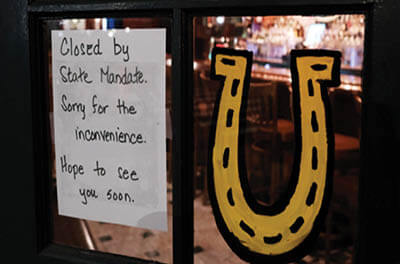 A Brooklyn restaurant tells would-be customers it is closed on Sunday, after a decree that all bars and restaurants in New York City shut down.