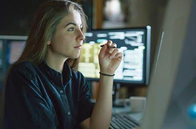 Young woman looking at a computer screen