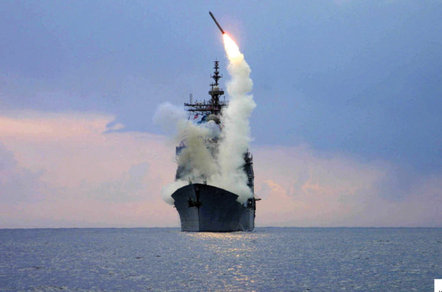 A Tomahawk Land Attack Missile (TLAM) is launched from the guided missile cruiser USS Cape St. George in the eastern Mediterranean Sea March 23, 2003.