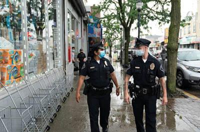 Police officers Natalie Perez and Alexander Baldwin patroling in Camden, N.J., on June 11.