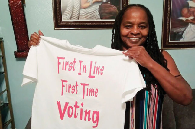 Betty Riddle of Sarasota, Fla., holds the T-shirt she wore on March 17 when she voted for the first time. A federal judge has gutted a Florida law requiring felons to pay all fines and fees before they can register to vote