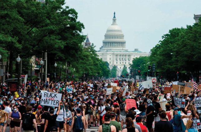 Protesters walk from the Capitol to the White House on Saturday.