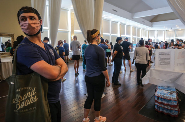 Voters wait in line to cast their ballots in the state's primary election on Tuesday in Atlanta