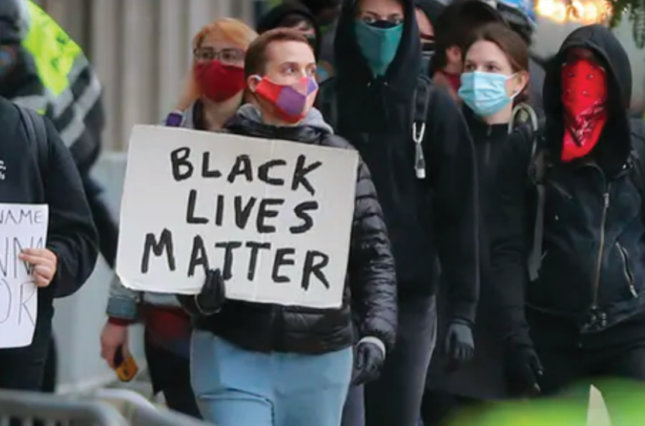 Protesters in front of Boston Police Headquarters during a United Against Racist Police Terror Rally on June 7, 2020