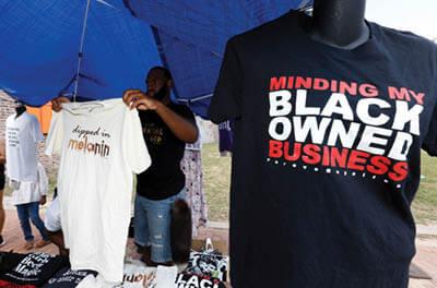 Street vendor selling t-shirts