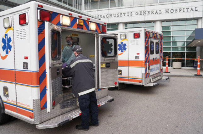 Ambulance and health care worker outside Massachusetts General Hospital