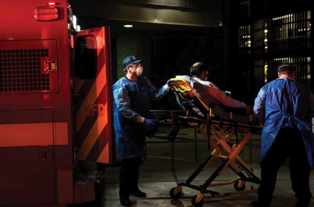Medics bringing a patient to Houston Methodist Hospital in June 2020