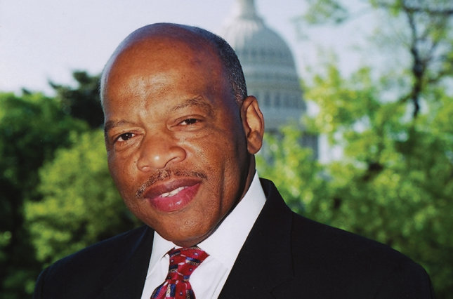 Portrait photo of John Lewis in front of the U.S. Capitol building