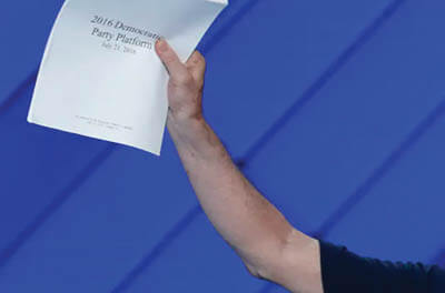 At the 2016 Democratic National Convention, a delegate holds up a copy of the Democratic Party Platform.
