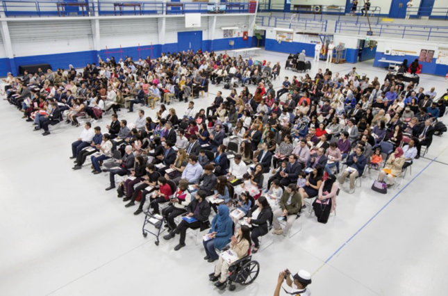 More than 250 people are shown becoming new Canadians at a citizenship ceremony on May 2, 2020, held at the Royal Canadian Navy local reserve division HMCS York.