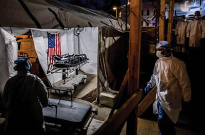 The transport team moves the body bags of deceased COVID-19 patients from the overflowing morgue of Brooklyn's Wyckoff Heights Medical Center into the improvised morgue set up outside on April 27