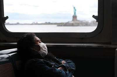 The Staten Island Ferry passing the Statue of Liberty in New York City