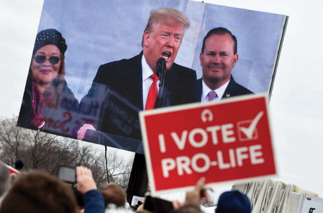 Anti-abortion demonstrators listen to President Trump at the March for Life in Washington in January 2020