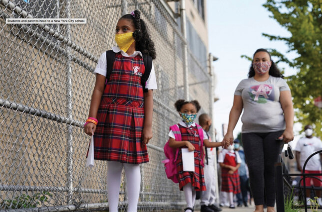 Students and parents walk to a New York City school