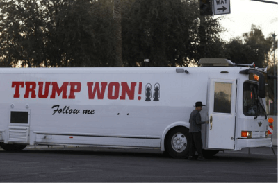 A supporter of Donald Trump arrives by bus at a protest in Phoenix Arizona